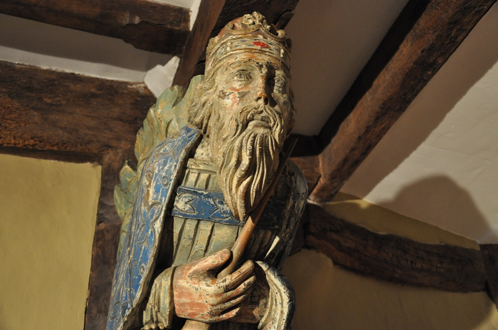 Late medieval roof carving depicting a royal saint (likely Edward the Confessor), c1480.