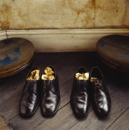 View of two pairs of polished black men's shoes stuffed with paper, found in Walter's Room of Mr Straw's House, Nottinghamshire