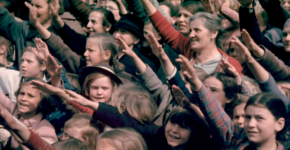 Happy and excited crowds saluting Germans at Schwarzach/St. Veith during Hitler's Austrian election campaign.  (Photo by Hugo Jaeger)