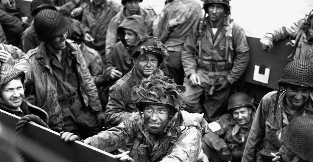 Allied troops packed tightly into an aquatic landing craft wait for their turn to face the Germans at Normandy