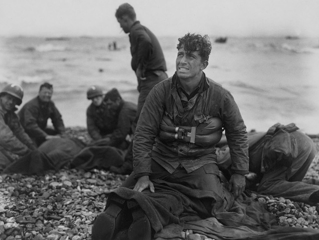American soldiers on Omaha Beach recover the dead after the June 6, 1944, D-Day invasion of France