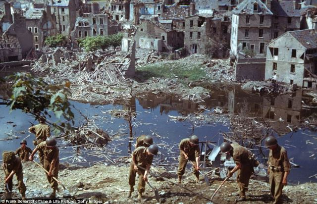 American troops clear wreckage in days after D-Day