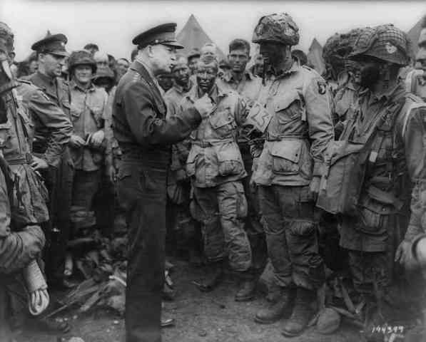 Gen. Dwight D. Eisenhower addresses American paratroopers in England on the evening of June 5, 1944, as they prepare for the Battle of Normandy