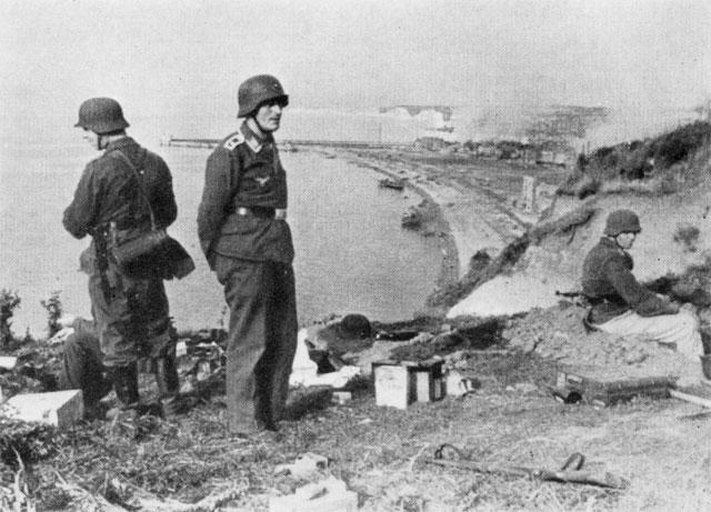 German troops observe the beach