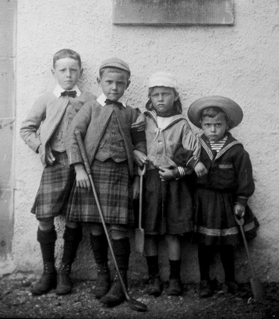Victorian children in traditional wear, 1890