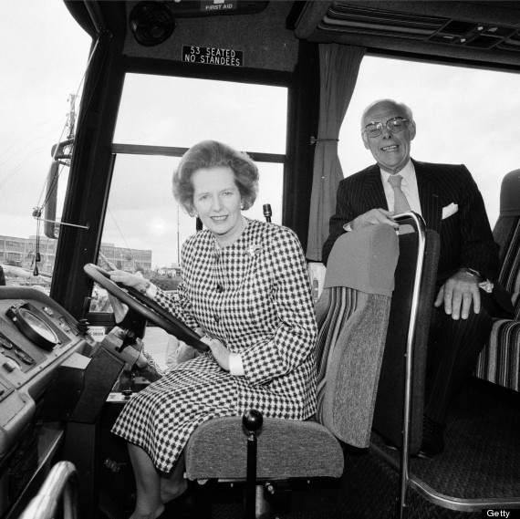 British prime minister Margaret Thatcher at the wheel of a coach with her husband Denis during the general election campaign, 22nd May 1978