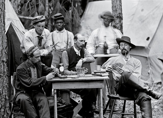 Officers of the 114th Pennsylvania Infantry Regiment play cards during the lengthy Siege of Petersburg