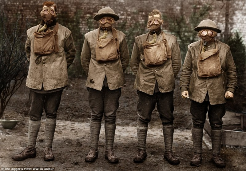 Australian troops are pictured in 'The Digger's View, WWI in Colour', wearing protective gas masks.